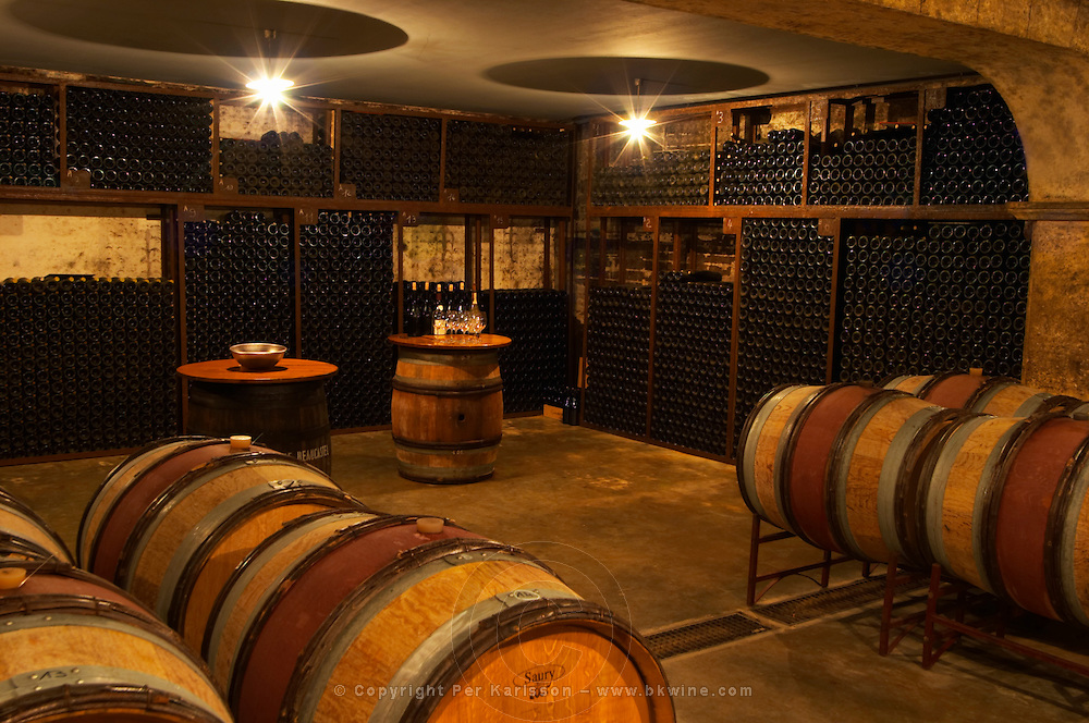A corner in the cellar where older vintages are stored. Arranged as a tasting room with some barrels in the foreground. Chateau de Beaucastel, Domaines Perrin, Courthézon Courthezon Vaucluse France Europe