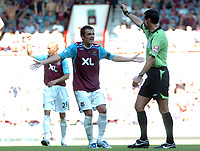 Photo: Tony Oudot.<br /> West Ham United v Wigan Athletic. The FA Barclays Premiership. 25/08/2007.<br /> Matthew Etherington of West Ham complains to referee Andre Marriner