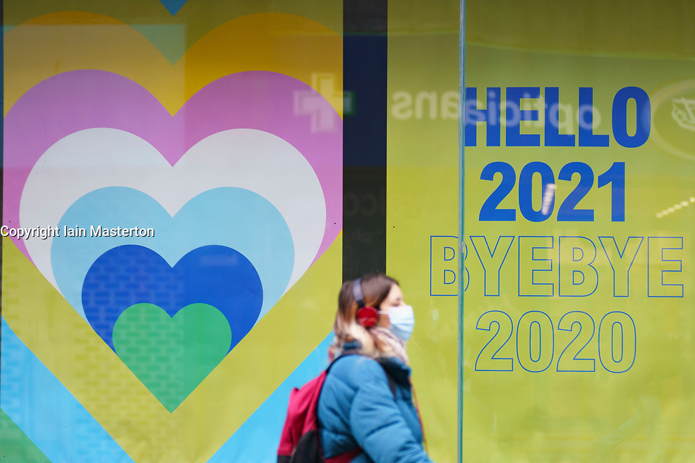 Glasgow, Scotland, UK. 7 January 2020. Scenes from morning in Glasgow city centre during the national Covid-19 lockdown. Normally busy streets are almost deserted because most shops and non essential businesses are closed.  Pic; Shop window display tries to improve the mood of desolation.   Iain Masterton/Alamy Live News