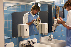 08 March 2008: North Carolina Tar Heels men's lacrosse attackman Ian Morrison (2) cleans his shoes pregame before playing the Notre Dame Fighting Irish in Chapel Hill, NC.
