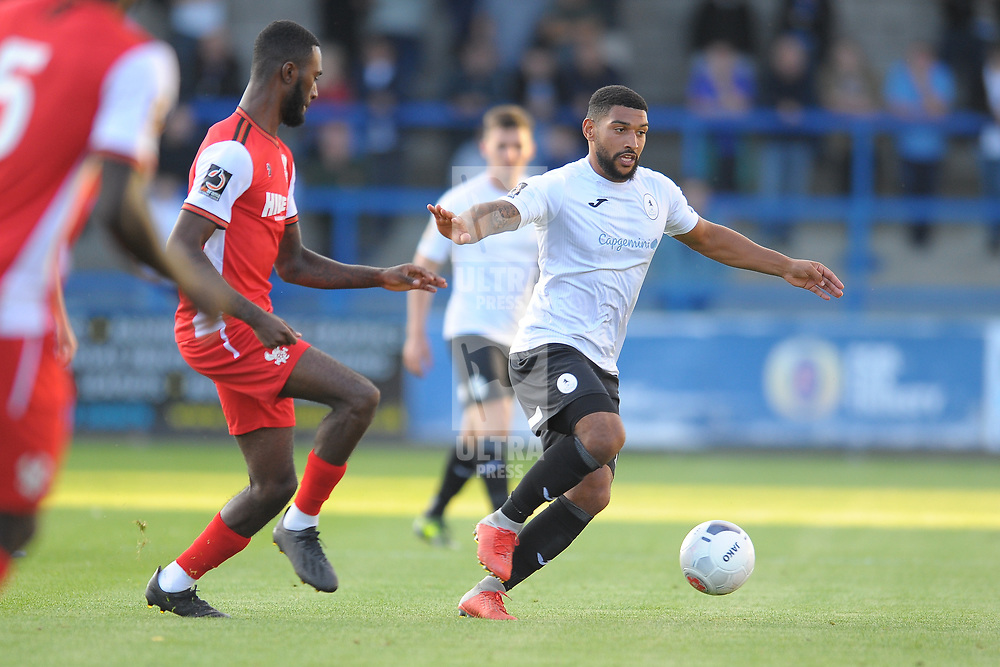 TELFORD COPYRIGHT MIKE SHERIDAN Telford's Ellis Deeney holds off Kacey Milan Butterfield during the National League North fixture between AFC Telford United and Kidderminster Harriers on Tuesday, August 6, 2019.<br /> <br /> Picture credit: Mike Sheridan<br /> <br /> MS201920-006