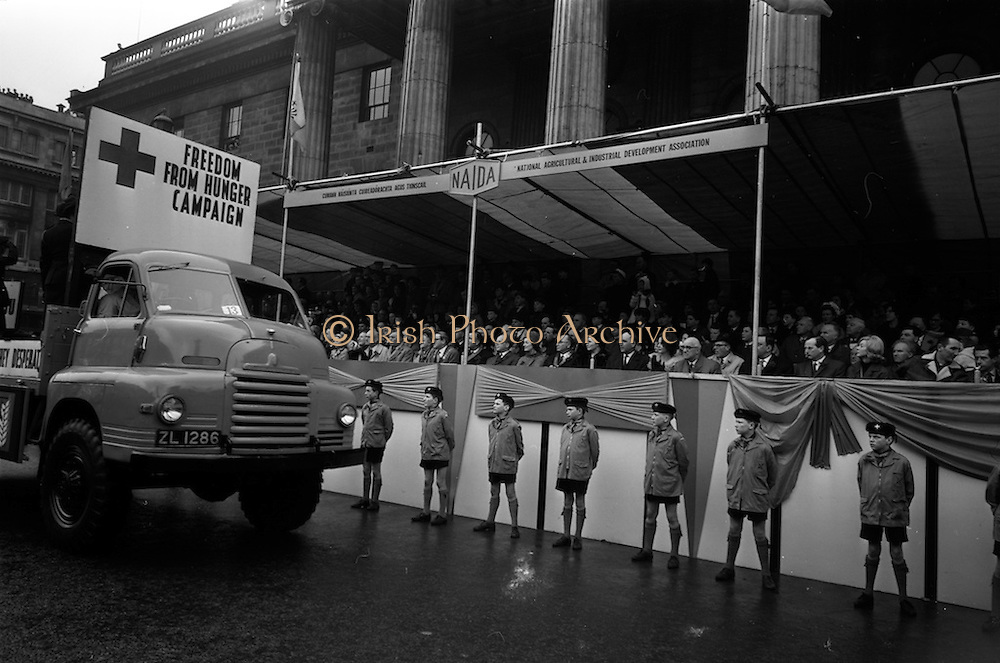 17/03/1965<br /> 03/17/1965<br /> 17 March 1965<br /> NAIDA St. Patrick's Day Parade, Dublin. Red Cross Freedom from Hunger campaign float passing the reviewing stand outside the GPO on O'Connell Street.