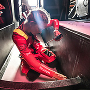 Leg 4, Melbourne to Hong Kong, day 05 on board MAPFRE, sophie Ciszek with the endoscope, checking there is nothing on the keel or the rudders. Photo by Ugo Fonolla/Volvo Ocean Race. 06 January, 2018.