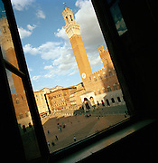View of the Piazza Del Campo and the Torre del Mangia through window , Siena, Tuscany, Italy