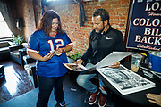 SHOT 12/10/17 1:16:17 PM - Former Buffalo Bills wide receiver and Hall of Fame player Andre Reed signs autographs and meets with fans at LoDo's Bar and Grill in Denver, Co. as the Buffalo Bills played the Indianapolis Colts that Sunday. Reed played wide receiver in the National Football League for 16 seasons, 15 with the Buffalo Bills and one with the Washington Redskins. (Photo by Marc Piscotty / © 2017)