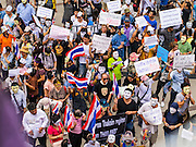"""02 JUNE 2013 - BANGKOK, THAILAND:   A crowd of anti-government protesters on a plaza in Bangkok. The so called White Mask protesters are strong supporters of the Thai monarchy. About 300 people wearing the Guy Fawkes mask popularized by the movie """"V for Vendetta"""" and Anonymous, the hackers' group, marched through central Bangkok Sunday demanding the resignation of Prime Minister Yingluck Shinawatra. They claim that Yingluck is acting as a puppet for her brother, former Prime Minister Thaksin Shinawatra, who was deposed by a military coup in 2006 and now lives in exile in Dubai.   PHOTO BY JACK KURTZ"""