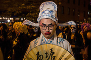 New York, NY - 31 October 2015. An Asian man ornately costumed and made up as a Japanese geisha in the Greenwich Village Halloween Parade.