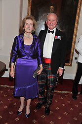 MAJOR GENERAL CHARLES RAMSAY and his wife MARY RAMSAY at a dinner in aid of Caring For Courage - The Royal Scots Dragoon Guards Afghanistan Welfare Appeal held at The Royal Hospital Chelsea, London SW3 on 20th October 2011.