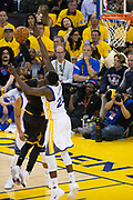 Golden State Warriors forward Draymond Green (23) tries to block Cleveland Cavaliers guard Kyrie Irving (2) during a lay up attempt during Game 2 of the NBA Finals at Oracle Arena in Oakland, Calif., on June 4, 2017. (Stan Olszewski/Special to S.F. Examiner)