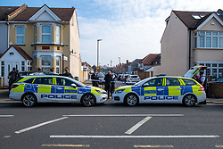 © Licensed to London News Pictures. 22/03/2021. London, UK. Police vehicles form a cordon following a disturbance at a premises in Granville Avenue, Hounslow. Metropolitan Police attended at approximately 03:20GMT and found two men suffering stab injuries. A man, aged in his 20s, was treated at the scene but died at 04:23GMT. The second man, also aged in his 20s, was taken to hospital. His injuries were assessed and he has since been discharged. Photo credit: Peter Manning/LNP