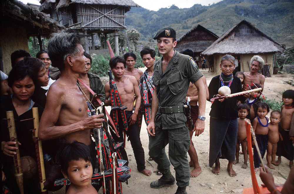 American Special Forces seen during a visit to make friends with the local tribe of Montanards in the Central Highlands of Vietnam during the war. April 1969. Photographed by Terry Fincher