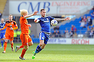 Cardiff City's Joe Ralls (r) goes past  Ben Pringle of Ipswich (l). Skybet football league championship match, Cardiff city v Ipswich Town at the Cardiff city stadium in Cardiff, South Wales on Saturday 12th March 2016.<br /> pic by Carl Robertson, Andrew Orchard sports photography.