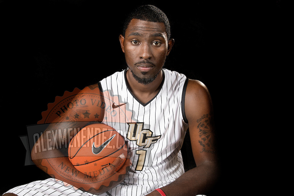 Forward Tristan Spurlock poses during the Knights media day event at the University of Central Florida CFE Arena on Monday, October 7, 2013 in Orlando, Florida. (AP Photo/Alex Menendez)