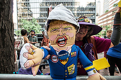 """August 21, 2017 - New York City, New York, United States of America - New Yorkers demonstrate at 780 3rd avenue in Manhattan, the location of the Bank of Korea and the offices of Senator Chuck Schumer and Kirstin Gillibrand, against the sabre-rattling by both the Trump Administration and the government of the DPRK, also known as North Korea.  The group claims North Korea has """"no nuclear capabilityâ (Credit Image: © Sachelle Babbar via ZUMA Wire)"""