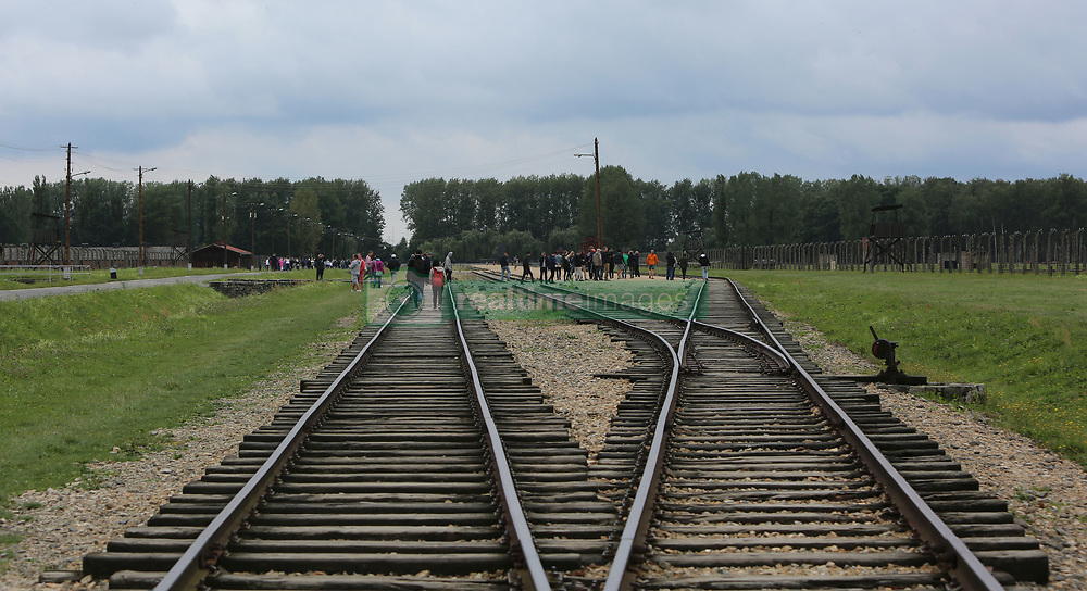 Rail tracks leading to the platform where the selection process took place at the Auschwitz-Birkenau Nazi concentration camps in Auschwitz, Poland on September 3, 2017. Auschwitz concentration camp was a network of German Nazi concentration camps and extermination camps built and operated by the Third Reich in Polish areas annexed by Nazi Germany during WWII. It consisted of Auschwitz I (the original camp), Auschwitz II–Birkenau (a combination concentration/extermination camp), Auschwitz II–Monowitz (a labor camp to staff an IG Farben factory), and 45 satellite camps. In September 1941, Auschwitz II–Birkenau went on to become a major site of the Nazi Final Solution to the Jewish Question. From early 1942 until late 1944, transport trains delivered Jews to the camp's gas chambers from all over German-occupied Europe, where they were killed en masse with the pesticide Zyklon B. An estimated 1.3 million people were sent to the camp, of whom at least 1.1million died. Around 90 percent of those killed were Jewish; approximately 1 in 6 Jews killed in the Holocaust died at the camp. Others deported to Auschwitz included 150,000 Poles, 23,000 Romani and Sinti, 15,000 Soviet prisoners of war, 400 Jehovah's Witnesses, and tens of thousands of others of diverse nationalities, including an unknown number of homosexuals. Many of those not killed in the gas chambers died of starvation, forced labor, infectious diseases, individual executions, and medical experiments. In 1947, Poland founded a museum on the site of Auschwitz I and II, and in 1979, it was named a UNESCO World Heritage Site. Photo by Somer/ABACAPRESS.COM