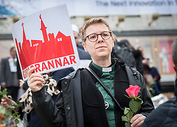 """10 April 2017, Stockholm, Sweden: Three days after a lorry was driven into a store in central Stockholm, killing at least four people and injuring many more, an interreligious service was held at Sergels torg in central Stockholm, to commemorate the victims of violence, and to pray together, for a future of compassion and peace together. The event was attended by representatives of a range of religions present in Stockholm and Sweden as a whole. Here, Kikki Högdahl from the Katarina Parish of Church of Sweden. Kikki is coordinator of the interreligious project """"Goda Grannar"""" ('Good Neighbours'). Oral consent obtained for use by Church of Sweden and the World Council of Churches."""