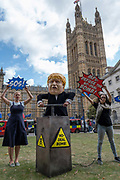A man imitating British Prime Minister Boris Johnson pretends to set off a fake bomb as Brexit campaigners gather outside Westminster on the first day after summer recess on 3rd September 2019 in London in the United Kingdom. MPs return to Westminster for a Brexit shutdown that could result in a general election.