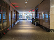 """20 MARCH 2020 - DES MOINES, IOWA: The empty lobby of 801 Grand, the tallest office tower in Iowa, Friday morning. The building is a part of the campus of Principal, a large financial services company. The building was shutdown Friday after a visitor tested positive for COVID-19. Some workers were placed in self quarantine and all were ordered to work from home. On Friday morning, 20 March, Iowa reported 45 confirmed cases of the Coronavirus. Restaurants, bars, movie theaters, places that draw crowds are closed for at least 30 days. There are no """"shelter in place"""" orders in effect anywhere in Iowa but people are being encouraged to practice """"social distancing"""" and many businesses are requiring or encouraging employees to telecommute.      PHOTO BY JACK KURTZ"""