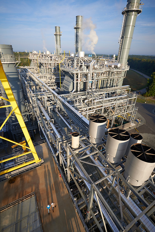 Duke Energy HF Lee Combined Cycle Facility/ Workers Walking In Early Morning Sun.