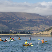 Kayakers on the water of Diamond Lake during the Paradise Triathlon and Duathlon series with breathtaking views of Mount Aspiring National Park, Paradise, Glenorchy, South Island, New Zealand. 18th February 2012. Photo Tim Clayton