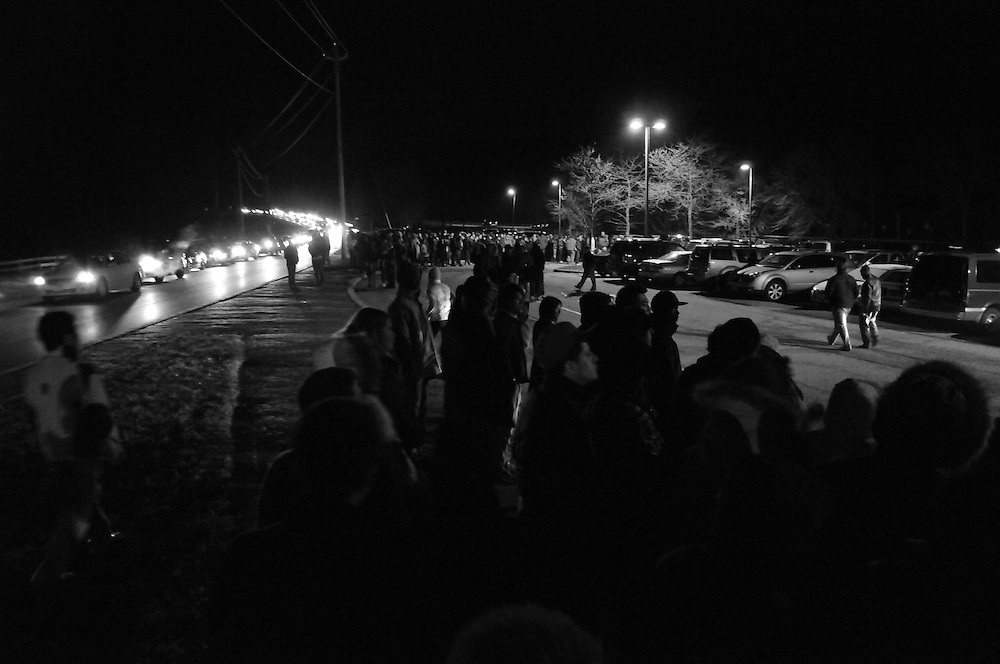 Shoppers wait for busses to take them from the overflow parking lot to Woodbury Commons outlet mall, Black Friday Nov. 28 2008. Already having been through hours of stop and go traffic, shoppers will have to wait even longer before they are able to board a bus and make it to the mall where more lines await.