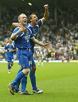 Photo: Aidan Ellis.<br /> Leeds United v Cardiff City. Coca Cola Championship. 19/08/2006.<br /> Cardiff's Willo Flood celebrates his goal with Michael Chopra