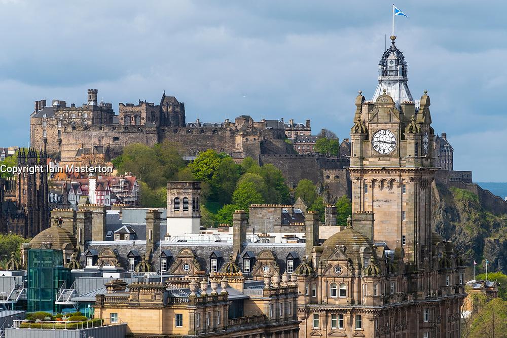 Skyline view of Edinburgh Castle and clocktower of Balmoral Hotel in Edinburgh, Scotland, UK