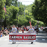 CANASTOTA, NY - JUNE 14: Students hold a banner in remembrance of past world boxing champion Carmen Basilio during the parade at the International Boxing Hall of Fame induction Weekend of Champions events on June 14, 2015 in Canastota, New York. (Photo by Alex Menendez/Getty Images) *** Local Caption ***