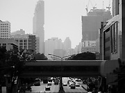 """14 JANUARY 2019 - BANGKOK, THAILAND:       Air pollution obscures the Bangkok skyline looking down Phaya Thai Road. Bangkok has been blanketed by heavily polluted air for almost a week. Monday morning, the AQI (Air Quality Index) for Bangkok  was 182, worse than New Delhi, Jakarta, or Beijing. The Saphan Kwai neighborhood of Bangkok recorded an AQI of 370 and the Lat Yao neighborhood recorded an AQI of 403. An AQI above 50 is considered unsafe. Public health officials have warned people to avoid """"unnecessary"""" outdoor activities and wear breathing masks to filter out the dust.    PHOTO BY JACK KURTZ"""