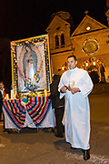 A Roman Catholic priest escorts a likeness of the Virgin Mary during a procession from the Cathedral Basilica of St. Francis of Assisi celebrating our Lady of Guadalupe December 11, 2015 in Santa Fe, New Mexico. Guadalupanos as the devotees are known, celebrate the apparitions of the Virgin Mary to an Aztec peasant at Tepeyac, Mexico in 1531.