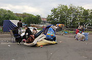 Romanian Roma Gypsies leave their makeshift squatter camp, after being forcibly evicted. The camp will be destroyed by bulldozers the same day. Seine St Denis, Paris suburbs<br /><br />Roma Gypsies in Paris: Romanian Roma living in difficulty who have come to France looking for a better live, find themselves in a similiar predicament, facing racism from the general populus and systematic controls and evictions from their makeshift squatter camps in the suburbs and temporary places of abode inside Paris. Some recycle metal or suft through the rubbish bins looking for items to sell. Others beg or play music looking for handouts from passers by. Paris and Banlieu, Ile de France, France April 2014