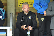Oxford United assistant manager watches from the stands during the EFL Sky Bet League 1 match between Wycombe Wanderers and Oxford United at Adams Park, High Wycombe, England on 15 September 2018.