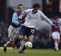 Picture: Henry Browne<br />Date: 01/03/2003<br />West Ham United v Tottenham Hotspur FA Barclaycard Premiership<br />Simon Davies of Spurs tries to escape from Lee Bowyer of West Ham