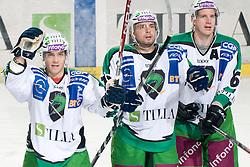Domen Vedlin, Petr Sachl and Bostjan Groznik of HDD Tilia Olimpija greets fans during ice-hockey match between HDD Tilia Olimpija and EHC Liwest Black Wings Linz in 19th Round of EBEL league, on November 7, 2010 at Hala Tivoli, Ljubljana, Slovenia. (Photo By Matic Klansek Velej / Sportida.com)