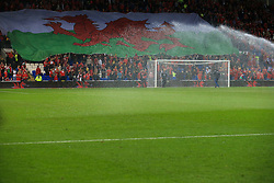 9 October 2017 -  2018 FIFA World Cup Qualifying (Group D) - Wales v Republic of Ireland - A giant Welsh flag is unfurled before kick off - Photo: Marc Atkins/Offside