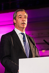 Methodist Central Hall, Westminster, March 17th 2015. Members of various housing groups from across the UK arrive at the Methodist Central Hall in London for the Homes for Britain Rally, which is aimed at highlighting the current housing crisis which affects low income workers, especially in London where rents and house prices are now well beyond their reach. PICTURED: UKIP leader Nigel Farrage addresses the rally.