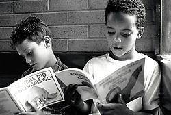 Primary schoolchildren reading, Nottingham UK 1992