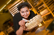 Restaurant baker puts final touches on a cake.<br /> <br /> NOT IN YOUR BUDGET? Contact Cathie for a price specific to your project.