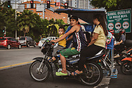 Family on a motorbike in Manila, Philippines. (July 23, 2019)