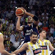 Fenerbahce Ulker's Omer ONAN (F), Gasper VIDMAR (2ndR) and Efes Pilsen's Charles SMITH (C), Kaya PEKER (R) during their Turkish Basketball league Play Off Final fourth leg match Fenerbahce Ulker between Efes Pilsen at the Abdi Ipekci Arena in Istanbul Turkey on Thursday 27 May 2010. Photo by Aykut AKICI/TURKPIX