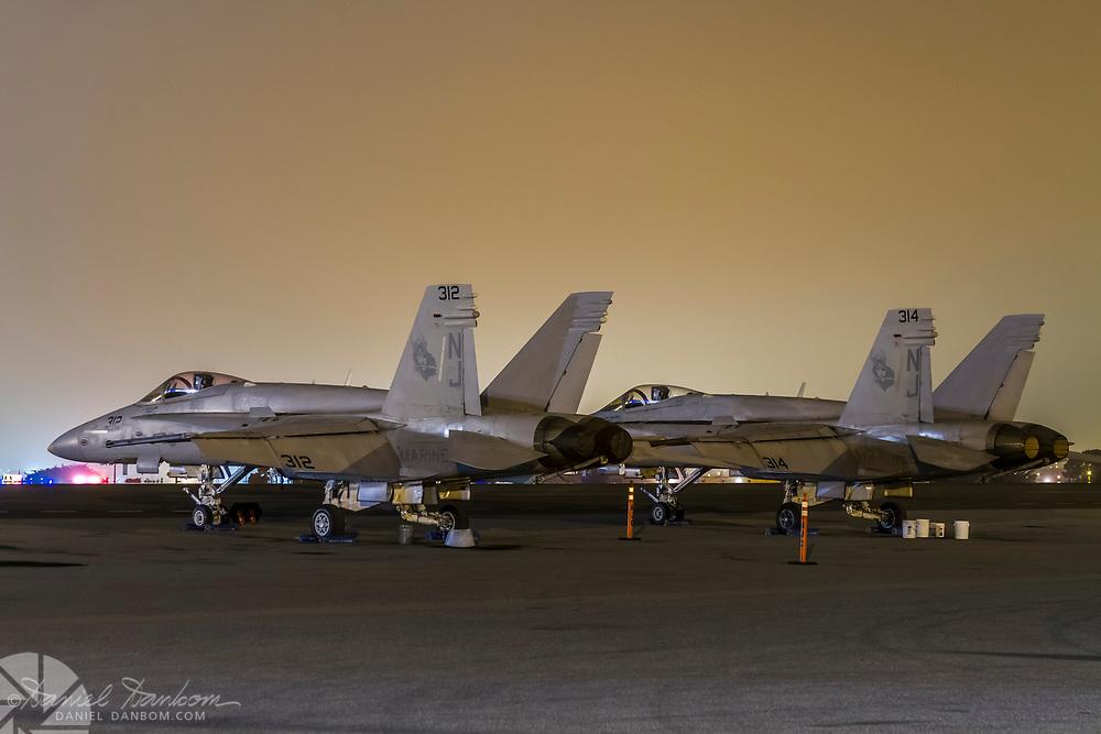 pair of F-18s on the ramp at night, MRY, Monterey, California