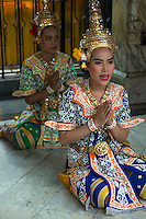 "Erawan Shrine Dancers - Erawan Shrine or ""San Phra Phrom"" in Thai is a Hindu shrine in Bangkok with a statue of the Hindu creation god Brahma or Phra Phrom as it is known in Thai. The shrine features performances by resident Thai dance troupes who are hired by worshippers for making merit.  Erawan Shrine was built in 1956 so as to eliminate the bad karma that was believed to have been caused by laying the foundations of a hotel being built on the wrong date.  The hotel's construction was delayed by a series of troubles: injuries to laborers, budget and the loss of a Italian marble intended for the building. Another dark mark on the location was that Ratchaprasong Intersection had once been used to publicly display and humiliate criminals."