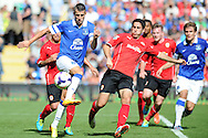 Everton's Kevin Mirallas (l) in action. Barclays Premier league, Cardiff city v Everton at the Cardiff city Stadium in Cardiff,  South Wales on Saturday 31st August 2013. pic by Andrew Orchard,  Andrew Orchard sports photography,