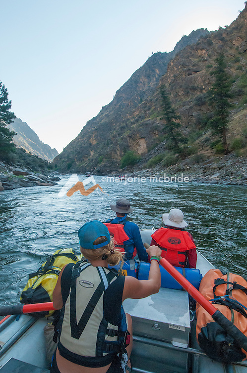 Couple enjoying the ride in The Impassible Canyon on the Middle Fork of the Salmon River during six day rafting vacation, Idaho.