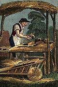 'The Brick Maker forming a brick by filling mould with clay.  Bricks placed on hack barrow in foreground. In background, a stack of bricks drying out before firing. From ''The Book of English Trades'', London, 1823.'