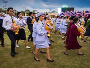 05 DECEMBER 2015 - BANGKOK, THAILAND: Thai civil servants participate in a parade of the King's Birthday on Sanam Luang in Bangkok. Thais marked the 88th birthday of Bhumibol Adulyadej, the King of Thailand,  Saturday. The King was born on December 5, 1927, in Cambridge, Massachusetts. The family was in the United States because his father, Prince Mahidol, was studying Public Health at Harvard University. He has reigned since 1946 and is the world's currently the longest serving monarch in the world and the longest serving monarch in Thai history. Bhumibol, who is in poor health, is revered by the Thai people. His birthday is a national holiday and is also celebrated as Father's Day. He is currently hospitalized in Siriraj Hospital, recovering from a series of health setbacks.    PHOTO BY JACK KURTZ