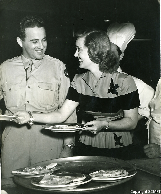 August 29, 1942 Bette Davis and a soldier at the premiere party for The Talk Of The Town at Ciro's Nightclub