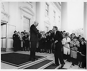 JFK Diary up for Auction<br /> <br /> After the end of the war in 1945, Ambassador Joseph Kennedy arranged for his 28-year-old son, Jack, to work for Hearst newspapers. This allowed the young veteran to attend the opening session of the United Nations in San Francisco in May and then travel abroad to cover post-war Europe during the Summer of 1945. <br /> <br /> JFK followed Prime Minister Churchill throughout England during his reelection campaign. He traveled to Ireland, France, then to the Potsdam Conference in Germany with Navy Secretary James Forrestal. He even viewed the charred remains of Hitler's bombed out bunker in Berlin and observed the Fuhrer's famed Berchtesgaden 'Eagle's Nest.'<br /> <br /> John F. Kennedy recorded his historic trip in a 61-page diary, documenting his personal observations of what he saw firsthand and perceptions of what would happen in the post-war world. This incredible manuscript reveals his insightful views and predictions of the world around him at an early age—a man who would, sixteen years later, become America's 35th President.<br /> <br /> Comprised of 61 loose-leaf pages, 12 handwritten and 49 typed, the diary is housed in a quality Trussell cowhide leather binder. <br /> <br /> Photo shows: President Eisenhower greets President-elect John F. Kennedy on the steps of the White House as the press corps looks on.<br /> December 6, 1960<br /> ©rrauction/Exclusivepix Media