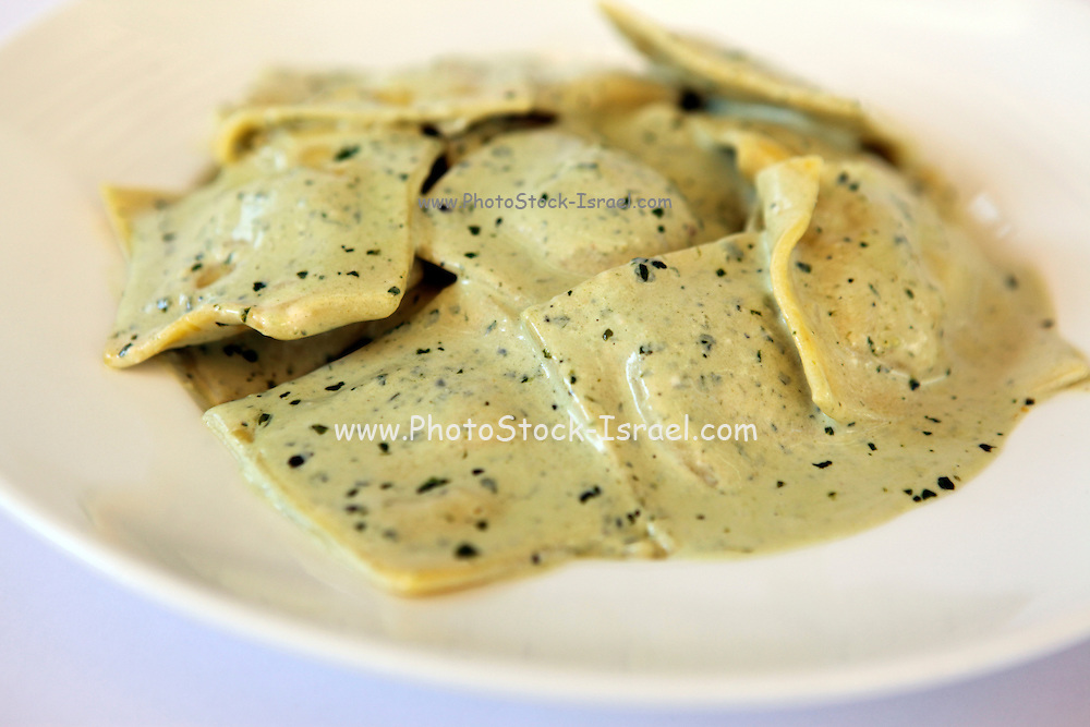 A plate of freshly cooked ravioli (stuffed pasta)