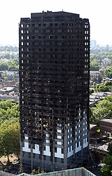 File photo dated 17/06/17 of Grenfell Tower in west London. The Prime Minister will be updated on the Grenfell Tower recovery effort later as the number of high rises feared to pose similar fire risks mounts.
